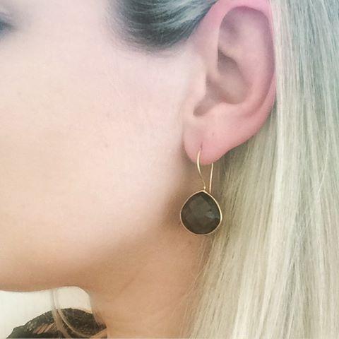 Model waering smokey quartz teardrop earring